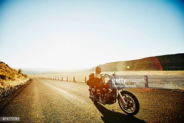 Motorcyclist on road trip on summer evening