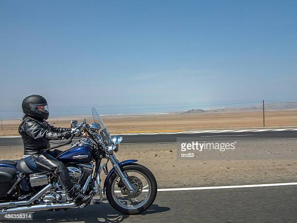 Motorcyclist on the pan-american highway in Peru