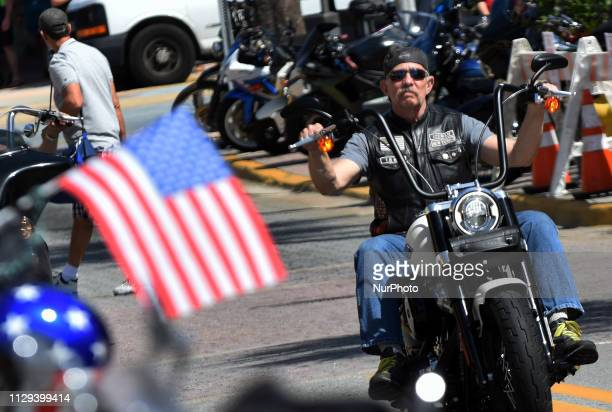 A motorcyclist parades down Main Street on March 8 2019 for the opening day of Bike Week in Daytona Beach Florida The 10day event which draws...