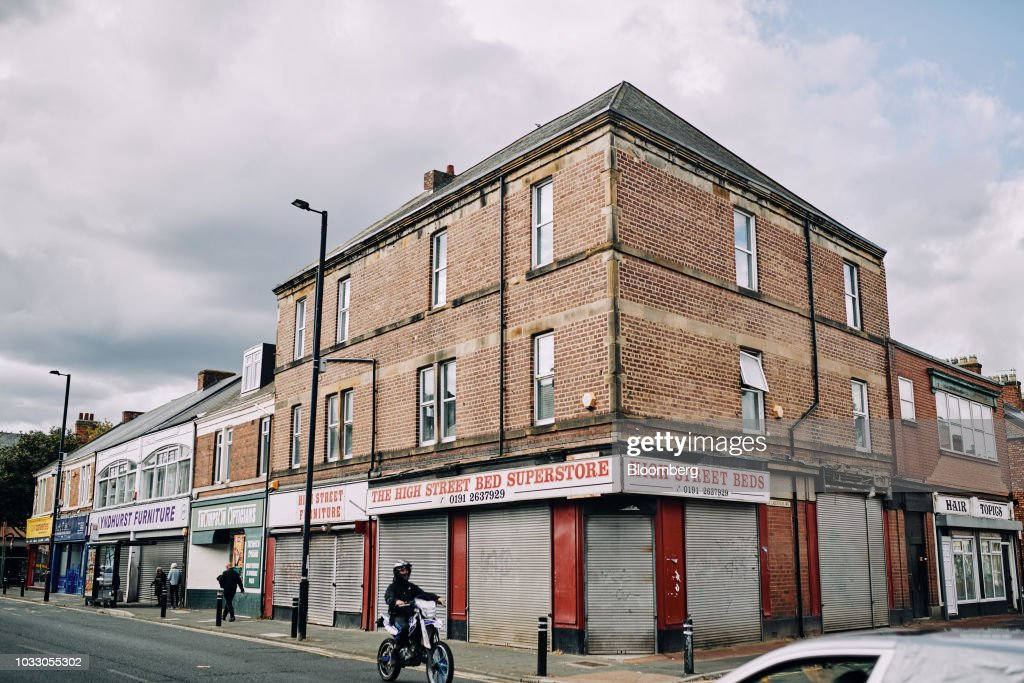 A motorcyclist passes shuttered furniture retail shops in Wallsend, U.K., on Thursday, Sept. 6, 2018. The northeast of England illustrates the precarious position facing many parts of the U.K. just six months before the country is due to leave the EU. Photographer: Matthew Lloyd/Bloomberg via Getty Images