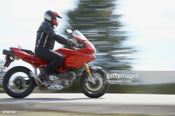 motorcyclist - ecchi biker stock pictures, royalty-free photos & images