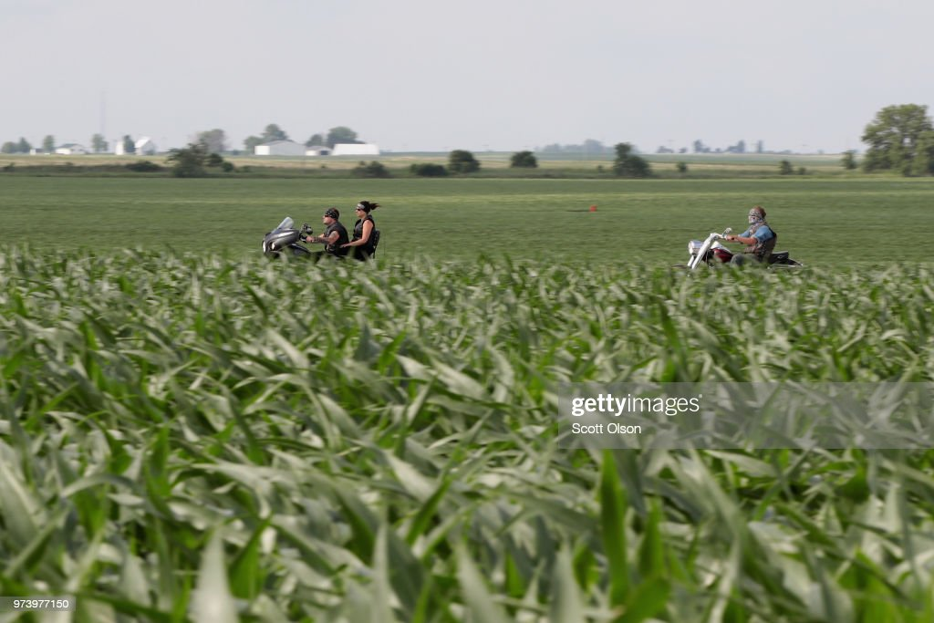 Motorcyclist ride past a corn field on June 13, 2018 near Dwight, Illinois. The condition of U.S. corn and soybean crops in most regions is far outpacing last year's condition at this point in the season.