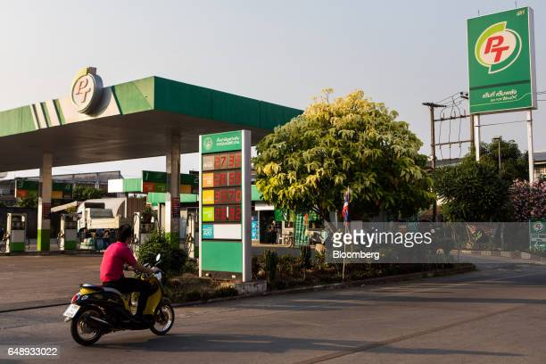 A motorcyclist rides past a PTG Energy Pcl gas station in Nan Nan Province Thailand on Friday March 3 2017 After more than a year of disinflation...