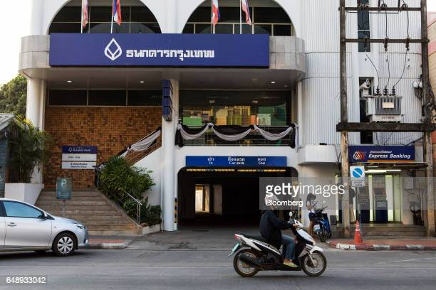 A motorcyclist rides past Bangkok Bank Pcl automated teller machines at a branch in Nan Nan Province Thailand on Friday March 3 2017 After more than...