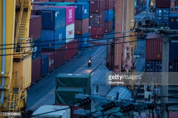 A motorcyclist rides past shipping containers stacked at the Bangkok Port in Bangkok Thailand on Wednesday Sept 2 2020 Thailand has reported zero...
