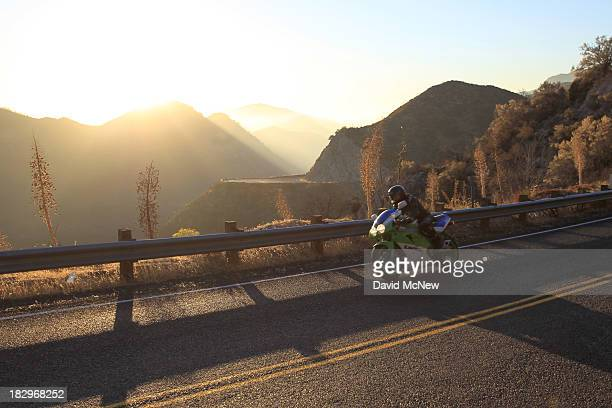 Motorcyclist rides the Angeles Crest Highway in the Angeles National Forest on October 2, 2013 in the San Gabriel Mountains, northeast of Los...