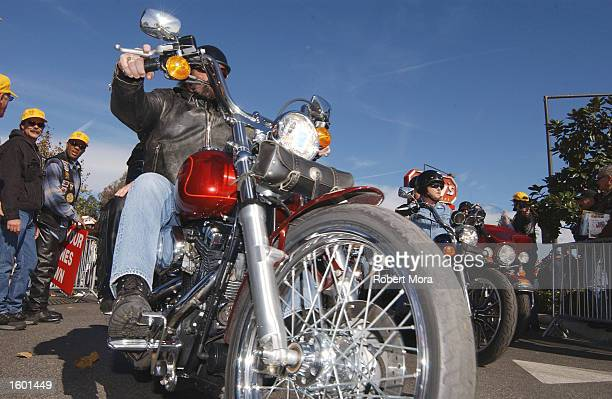 A motorcyclist starts his ride from Glendale to Castaic Lake at Love Ride 19 benefiting Reading By 9 and other charities on November 10 2002 in...
