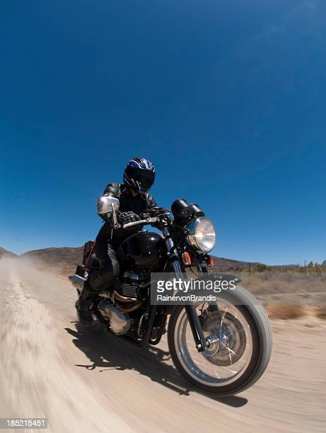 motorcyclist travelling on dirt road