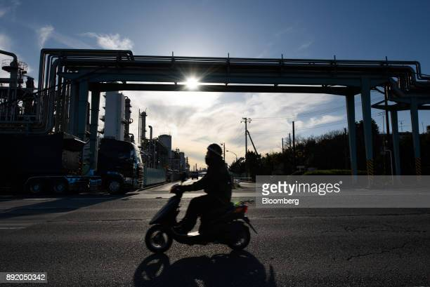 A motorcyclist travels past a chemical plant in the Keihin industrial area of Kawasaki Kanagawa Prefecture Japan on Tuesday Dec 12 2017 The Bank of...