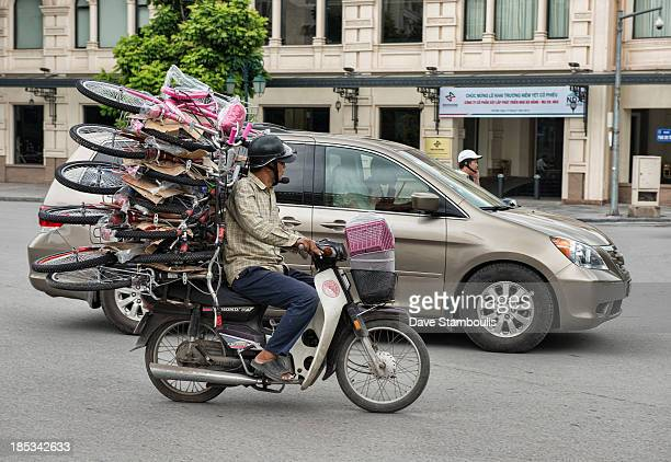 Motorcyclist with epic load of bicycles in Hanoi, Vietnam