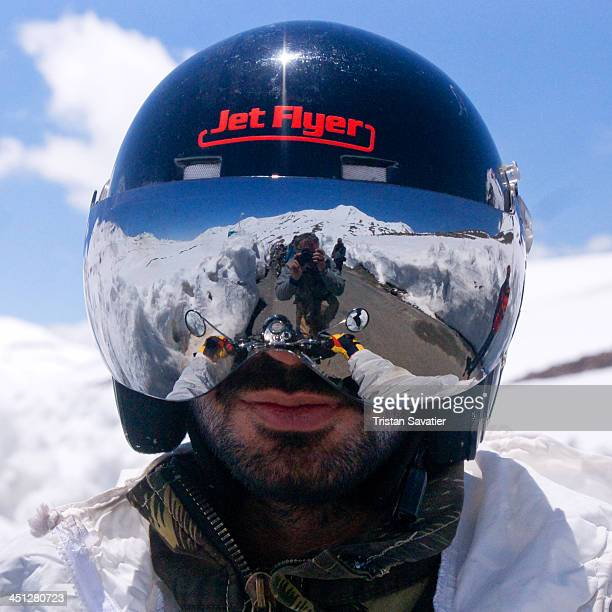 CONTENT] Motorcyclist with helmet visor reflecting the Himalaya mountains landscape on the ManaliLeh highway Ladakh is a popular tourist destination...