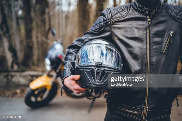 motorcyclist with his helmet - motorcycle stock pictures, royalty-free photos & images