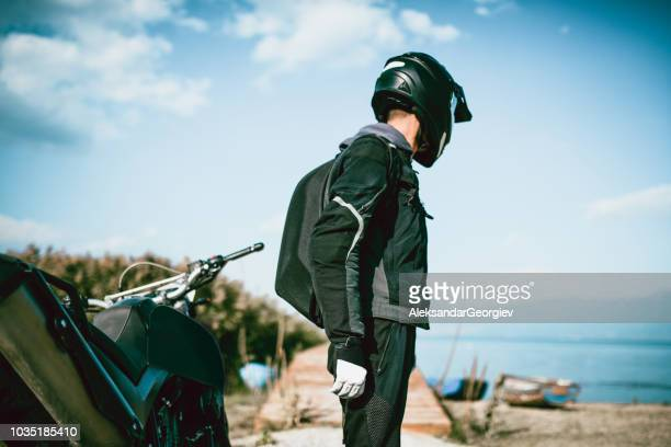 motorcyclist with specialized equipment arrived at destination - biker jacket stock pictures, royalty-free photos & images
