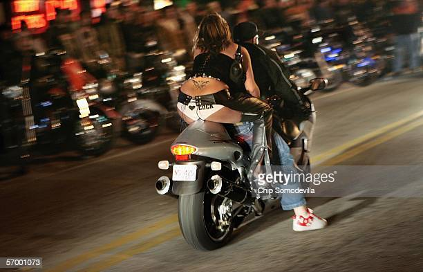 Motorcyclists and their riders cruise down Main Street during the first weekend of Bike Week March 4 2006 in Daytona Beach FL More than 500000 people...