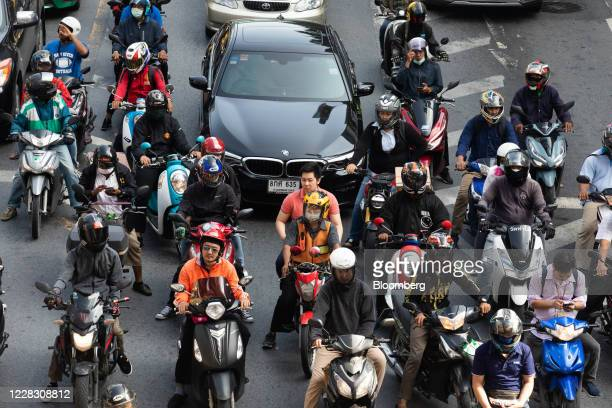 Motorcyclists and vehicles sit in traffic in Bangkok Thailand on Wednesday Sept 2 2020 Thailand has reported zero locallytransmitted Covid19 cases...