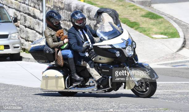 Motorcyclists carry a dog on their bike during a charity ride on September 30 2018 in Sydney Australia The Distinguished Gentleman's Ride is an...