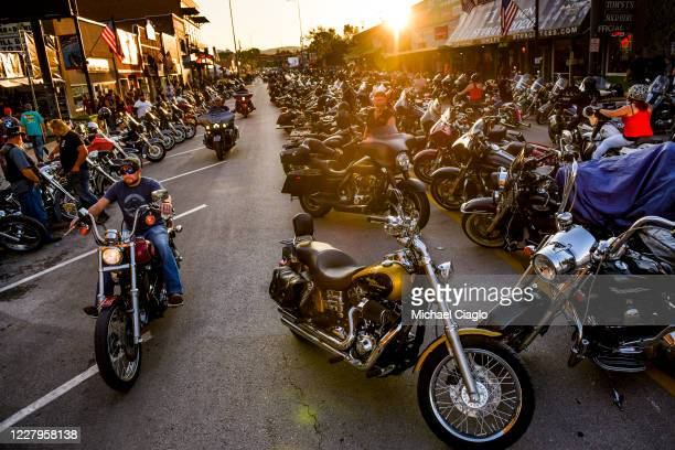 Motorcyclists drive down Main Street during the 80th Annual Sturgis Motorcycle Rally on August 7 2020 in Sturgis South Dakota While the rally usually...