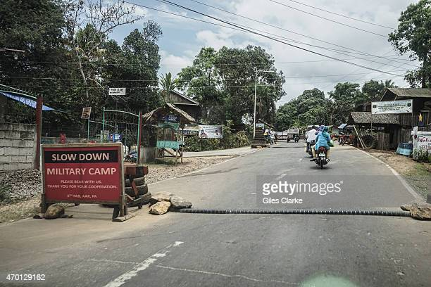 Motorcyclists drive through a Philippine military checkpoint in Isabela City on Basilan Island of the Sulu Archipelago March 27 2015