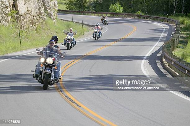 Motorcyclists driving the highways of the Black Hills during the 67th Annual Sturgis Motorcycle Rally Sturgis South Dakota August 612 2007
