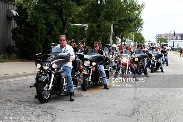 Motorcyclists from around the world approach the Summerfest Grounds parking lot which was the final destination of the parade to commemorate the...