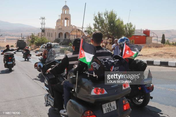 Motorcyclists from Syria Lebanon and Jordan take part in a ride to encourage tourism through the town of Saidnaya north of Syria's capital Damascus...