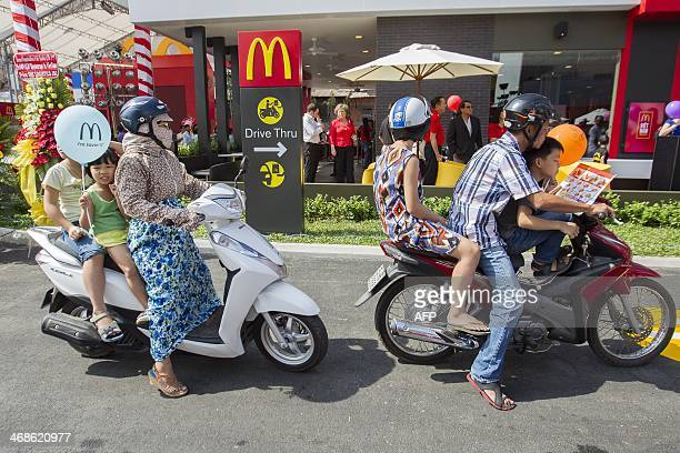Motorcyclists line up at the drivethrough area during the opening of the country's first McDonald's restaurant in Ho Chi Minh city on February 8 2014...