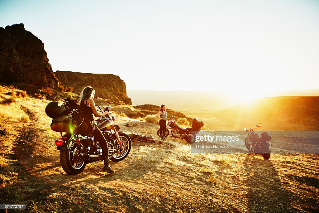 Motorcyclists on road trip stopping to camp : Stock Photo
