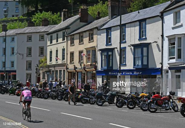 Motorcyclists park their bikes on the road in Matlock Bath in the Peak District in northern England on May 30, 2020 after the announcement of...