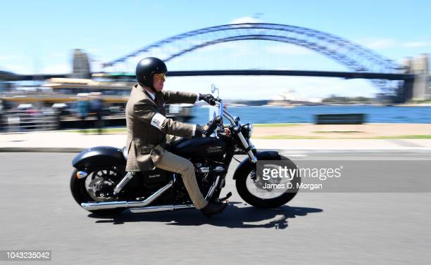 Motorcyclists pass the Harbour Bridge during a charity ride on September 30 2018 in Sydney Australia The Distinguished Gentleman's Ride is an annual...