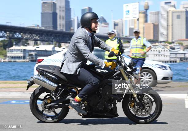 A motorcyclists passes two police officers during a charity ride on September 30 2018 in Sydney Australia The Distinguished Gentleman's Ride is an...