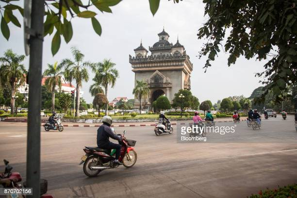 Motorcyclists ride around the Patuxai Victory monument in Vientiane Laos on Thursday Nov 2 2017 Located in the Mekong region Southeast Asia's...