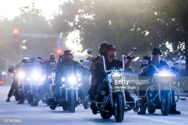Motorcyclists ride down Lazelle Street during the 80th Annual Sturgis Motorcycle Rally in Sturgis South Dakota on August 8 2020 While the rally...
