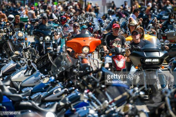 Motorcyclists ride down Main Street during the 80th Annual Sturgis Motorcycle Rally on August 7 2020 in Sturgis South Dakota While the rally usually...