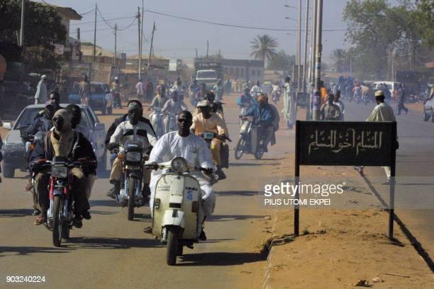 Motorcyclists ride in Gusau capital of Islamic state of Zamfara 29 November 2002 The Zamfarans have upheld their fatwa an Islamic religious decree...