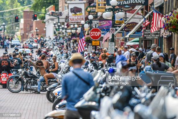 Motorcyclists ride through downtown Deadwood South Dakota during the 80th Annual Sturgis Motorcycle Rally on August 8 2020 While the rally usually...