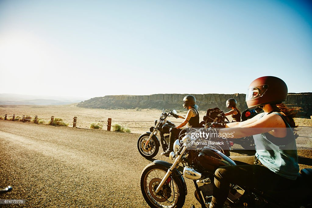 Motorcyclists riding together during road trip : Stock Photo
