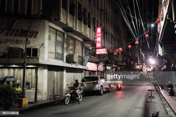 Motorcyclists sit parked at night in the Chinatown area of Manila the Philippines on Thursday May 3 2018 Home prices in the metropolitan Manila area...