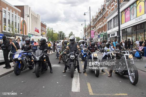 August 01: Motorcyclists take part in supporting Reparations March UK & Afrikan Emancipation Dayreclaim Brixton town centre in order to promote...