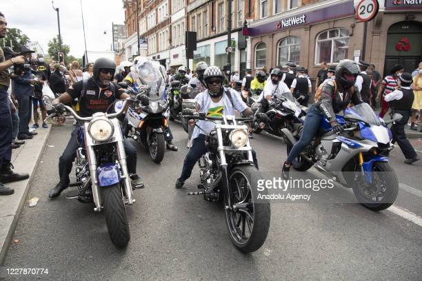 Motorcyclists take part in supporting Reparations March UK Afrikan Emancipation Day reclaim Brixton town centre in order to promote their demand of...