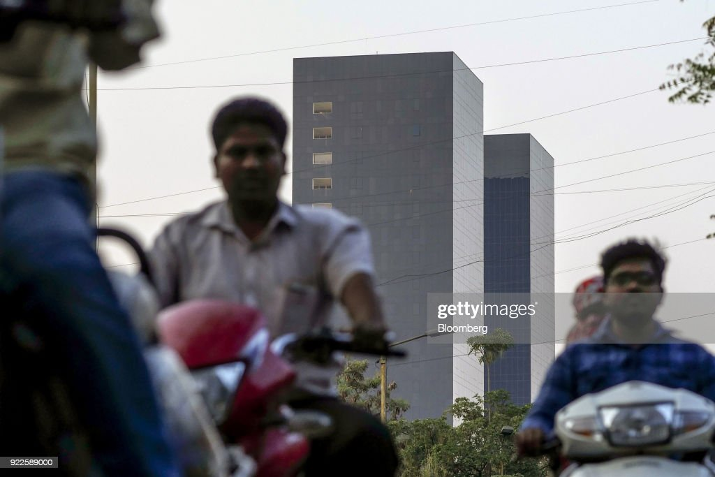 Motorcyclists travel along a road as the Trump Towers Pune complex, developed by Panchshil Corp Park Pvt., stands in Pune, Maharashtra, India, on Wednesday, Feb. 21, 2018. Donald Trump Jr. is slated to speak on foreign policy at an event in New Delhi where Indian Prime MinisterNarendra Modiis also scheduled to speak. Photographer: Dhiraj Singh/Bloomberg via Getty Images