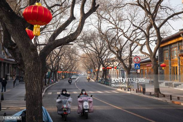 Motorcyclists travel along street with Chinese New Year decoration in Beijing, China, on Tuesday, Jan. 26, 2021. Beijings municipality is targeting...