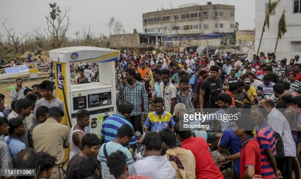 Motorcyclists wait in a queue at a gas station in Puri Odisha India on Sunday May 5 2019 Authorities launched a massive restorationandrelief effort...