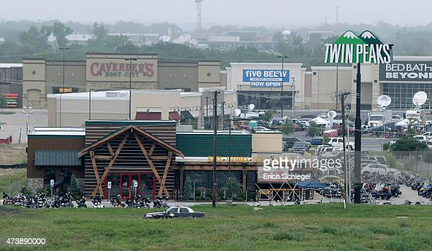 Motorcyles sit in the parking lot of the Twin Peaks restaurant, the scene of a motorcyle gang shootout, May 18, 2015 in Waco, Texas. A shootout...