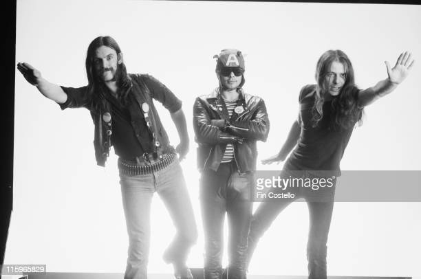 singer and bassist Lemmy Kilmister drummer Phil Taylor and guitarist Eddie Clarke British heavy metal band pose with Lemmy and Clarke standing either...