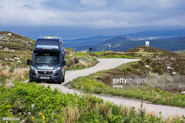 Motorhome at passing place on winding single track road in the Scottish Highlands, Scotland, United Kingdom.
