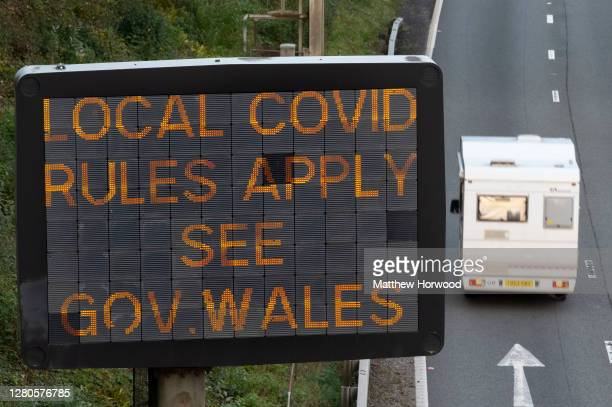 Motorhome drives past a sign on the M4 motorway which warns of local covid rules on October 16, 2020 in Cardiff, Wales. The Welsh First Minister Mark...