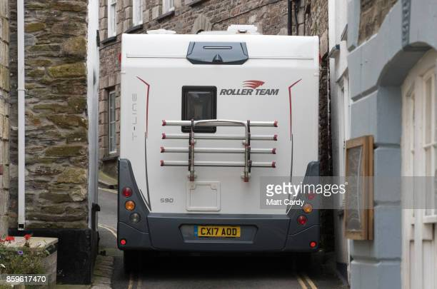 A motorhome drives through the narrow streets of the village of Mevagissey which has submitted plans to limit the number of second homes on October 9...