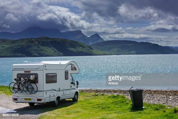 Motorhome parked on the shore along Kyle of Tongue, shallow sea loch in northwest Highland, Sutherland, Scottish Highlands, Scotland, UK.