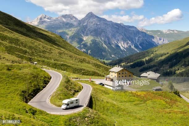 Motorhome Speeding on Alpine Road, Switzerland