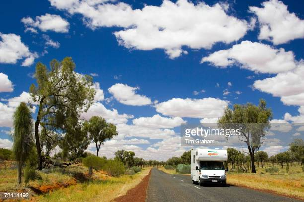 Motorhome travels road in the Red Centre Northern Territory Australia